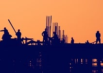 Civil Construction - Silhoutte of workers at construction site.