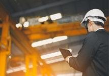Engineer monitoring work progress inside a workshop.